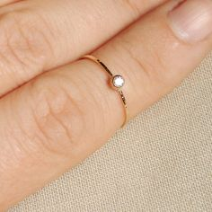 BACKORDERED  - Thread of Gold - Tiny Stacking Ring with 14k Gold Set Faceted Stone of Your Choice - Delicate Jewelry. $49.00, via Etsy.
