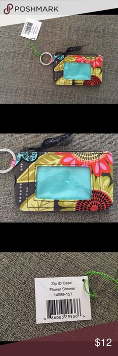 NWT Vera Bradley Zip ID Brand new with tags. Bought as gift but ended up not using. Print is Flower Shower. Use as Wristlet, wallet, ID holder, keychain. Vera Bradley Bags Wallets