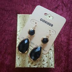 Tear Drop Shape Black and Gold Color Earrings Metal color is gold and acrylic is color black.  Length of earrings is 2 inches long. Jewelry Earrings