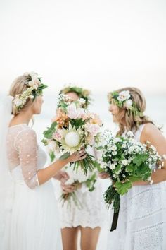 Flower crowns with green, white and pink protea bridal bouquets and bridesmaids in all white at this beach glamping wedding in Australia. Photo: Mark & Kara Photography