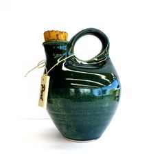 Yarra Glen Pottery 'Port' Carafe, with original pottery label & cork.  Originally label was tied with raffia but has been replaced with new string.  22.7cm tall x 14.5cm x 16.2cm  holds 1.5ltrs.