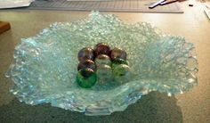 Lacey dish made by fusing and slumping tempered glass pieces