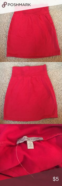 Red Charlotte Russe Mini Skirt Never worn, the plastic part of the tag is still attached but the actually price tag ripped off. Red mini skirt. Charlotte Russe Skirts Mini