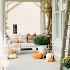 This classic slat-rail Sunday Porch Swing is hand crafted of eucalyptus to be naturally moisture and insect resistant, and finished in a warm whitewash.