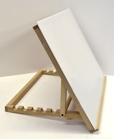 This solidly made table-top drawing table works as a portable, compact slant board and as a lightbox when a lightsource is added beneath the plexiglass. Durably constructed of smoothly finished wood, our easel features seven settings for your choice of angles.  Easel is 18'x24'. $63