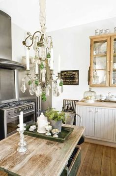 Rustic kitchen with some bling-bling <3 Love it. I love the chandelier over rustic counter!