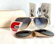 Vintage 1980s Carrera 5593 70 Sunglasses – Full Set – New Old Stock – Made in Austria // free shipping, link in bio // #carreraoptyl #vintagecarrerasunglasses #frenchpartofsweden #vintagesunglasses #miamivice #donjohnson #sonnycrockett #carrerasunglasses Vintage Sunglasses, Elegant, Carrera, Austria, Classic, Fashion, Eyeglasses, Blue, Nice Asses