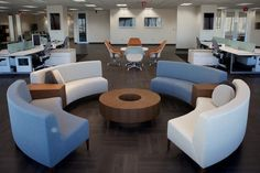 Another great open floor plan with a great circle of couches for collaboration and team meetings.