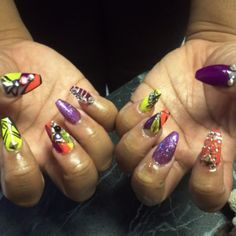 Square tip and blinged out purple and orange art at Nail Candy Beautique in Dallas, TX. #fall nails