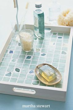 If you live by the ocean, search for tumbled sea glass. These smooth broken bits capture a frosted oceanic look and can be made into jewelry, stepping stones for the garden, or artwork. The one-of-a-kind pieces also lend themselves beautifully to mosaics, such as this bathroom tray. #marthastewart #crafts #diyideas #easycrafts #tutorials #hobby