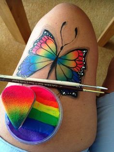 Rainbow butterfly with black accents. Love that she practices on her thigh like me lol