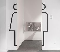 Restroom wayfinding in the Cooper Hewitt, Smithsonian Design Museum – by Pentagram.