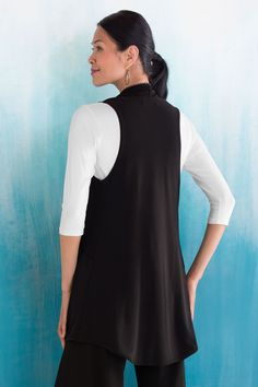Class Act Vest by Sympli . Oversized draped pockets create a flowing shape in an open-front vest with a curved hem—a perfect layering piece in smooth and supple matte jersey.