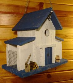 Charming Old world Birdhouse Barn with Two side bird feeders. This Birdhouse feeder combo is made by hand in my Shop and features Reclaimed Barn wood , Oak, Cedar and Pine are all used from farmstead materials, carved miniatures are made with re purposed metals and wood. Add some #birdhouses