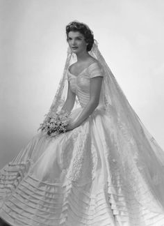 Jacqueline Kennedy Onassis in her wedding gown 12 September .cited as iconic and one of the best-remembered bridal gowns of all time. The wedding gown was the creation of Ann Lowe ft) of ivory silk taffeta. Jacqueline Kennedy Onassis, Jackie Kennedy Wedding, Jaqueline Kennedy, Jackie O's, John Kennedy, Caroline Kennedy, Jacklyn Kennedy, Jackie Kennedy Style, Celebrity Wedding Dresses