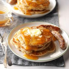 Apple Pancakes with Cider Syrup Recipe -Tender pancakes are filled with minced apple and raisin, and drizzled with apple cider syrup. They're wonderful in the summer or on a cool fall morning. —April Harmon, Greeneville, Tennessee