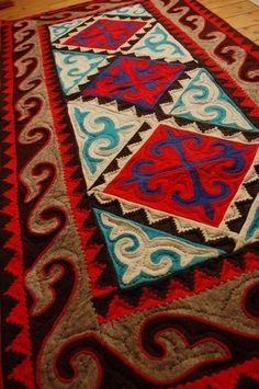 Folk art feel. I need to make a rug for my kitchen...