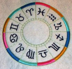 A zodiac wheel, by request.  This 5″ circle consists of 7,878 stitches in 10 threads. My next mission is to see if I can work the identifier in with each symbol. Not sure how it's going to play out.