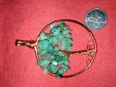 The first tree of life I made. Copper wire and aventurine chips. I really enjoyed making it