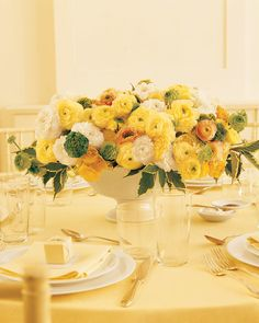 This sunny bunch of large and small blooms boasts creamy white, muted yellow, pale orange, and mossy green ranunculus for texture, white garden roses and yellow begonias for volume, and weigela leaves to complement the color scheme.