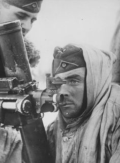 German mortarman fixes his firing angle for a Granatwerfer 34 in 81-mm somewhere on the Eastern Front in 1942.