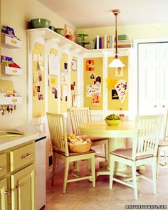 I love this kitchen with the cork boards, high shelf, and round table!