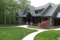 landscaping craftsman style home | New front yard with the lawn in, boxwoods along the front porch and a ...