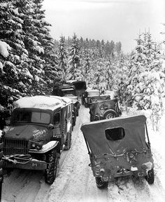 Deep snow banks on a narrow road halt military traffic in the woods of Wallerode, Belgium, January 30, 1945