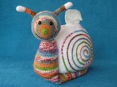 20 #Crochet Snails, Caterpillars, Slugs and Worms - patterns and inspiration including this tissue cozy sold on Etsy by Millionbells