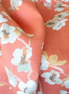 """""""Sakura, Kumquat"""" From the """"Asian Influence"""" collection comes a beautiful cherry blossom branches print fabric by Braemore in vibrant and pretty shades of tangy orange."""