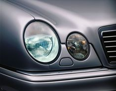 "Four eyes: The combination of four elliptic headlamps gave the new E-Class (W 210 series) its distinctive ""face"". This design had first been shown on a coupe study in 1993."