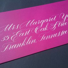 Formal calligraphy envelope addressing - such fun to address on vibrant pink envelopes!