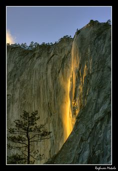 Yosemite's natural firefall: A number of conditions permitting, Horsetail Falls in Yosemite, turns into a ribbon of surreal color, backlit by the setting sun. This rare phenomenon can be witnessed a few days each February when the weather Gods co-operate with: sufficient snow at the source, warm weather to melt some of it and then a clear sunset in a usually cloudy and stormy February!