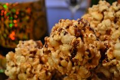 Salted Caramel Popcorn Balls with a Dark Chocolate Drizzle   #popcornballs #sweettreats #saltedcaramel