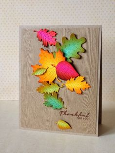 hand crafted Thanksgiving card from three umbrellas ... woodgrain background on kraft ... die cut leaves in bright colors toned down with sponged edges ... they glow! ... beautiful card ...