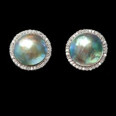 Eyris Pearl Earrings with diamonds.  Magnificent Eyris black cultured pearls from New Zealand displaying spectacular hues of azure blue, nautical green and a host of other iridescent colors only nature can create in a pearl.