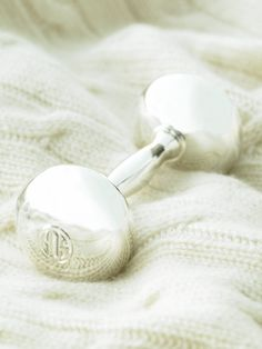 Sterling Silver Rattle Price: $350.00 Our elegant dumbbell rattle makes a charming gift for baby, crafted from beautiful sterling silver for timeless heirloom appeal.