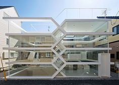 Maze-like Japanese house featuring an entirely transparent facade.