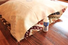 easy no sew pillow covers using liguid stitch or hot glue gun(can use shower curtains or duvet cover or anything as fabric)