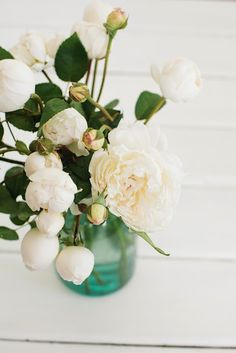 White flowers in turquoise vase.    Wedding Ideas | Wedding Themes | DIY Wedding | Once Wed