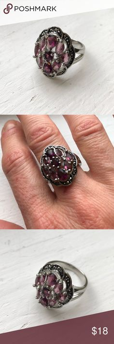 Amethyst & Marcasite Ring Not stamped, metal is likely rhodium played over brass. Amethyst stones with marcasite. Like new and never worn. Seems to be size 7 as it fits my middle right hand finger. jcpenney Jewelry Rings