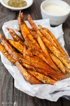 Baked Sweet Potato Fries with Za'atar   The Mediterranean Dish. Easy sweet potato fries recipe that is every bit as healthy, but tastes so indulgent! Wedges of sweet potatoes tossed in olive oil and Mediterranean spices including za'atar. A must try from TheMediterraneanDish.com