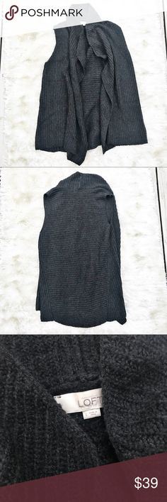 LOFT Charcoal Ribbed Sweater Vest In a chunky ribbed knit, this draped vest is one cool - and cozy - finishing layer. Draped foldover lapels. Open front. Dark charcoal. Retail $69.50. LOFT Jackets & Coats Vests