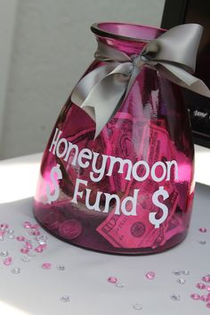 Honeymoon fund! The couple walked away with plenty of spending cash for he honeymoon.  The jar was $8 bucks from Hobby Lobby ( I bought it on a 50% off sale). And then I put vinyl on it cutout from my cricut machine.