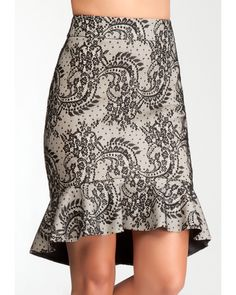 With trumpet-style silhouette, high low hem and beautiful jacquard pattern, this bebe skirt is a winter party must-have. Try it with your suiting pieces to give them a pretty print pop.