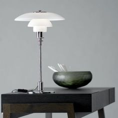 PH 3/2 designer lamp for the table. PH 3/2 is one of the most popular designs from danish Poul Henningsen.