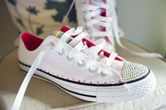 Converse + Crystal from eBay + Ribbon from a local haberdashery = fun, comfy, home decorated brides shoes.