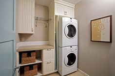 Asko stackable washer dryer laundry room traditional with dryer rack beadboard cabinets front loading washer and dryer