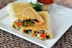 Crispy Southwest Chicken Wraps _ Talk about delish! And surprise, surprise they're healthy too! These flavorful wraps are loaded with chicken, veggies & rice. To make them extra delicious add cheddar cheese & sour cream (that's what we did) & I was in heaven with every bite! Serve warm with salsa. Enjoy! ♥