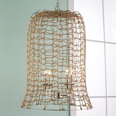 Jute Rope Weave Lantern - Large Modern beach chic describes this jute rope hanging lantern. The natural jute rope is woven around a chrome frame creating a trendy coastal style lantern. A fabulous foyer lantern or two over a dining room table make a stunning statement chandelier in a coastal casual setting.